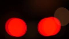 Defocussed blurry light - brake lights Stock Footage
