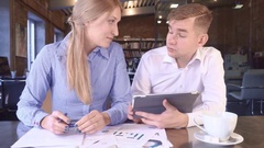 Team Members Woman and Man Look At A Tablet Together Stock Footage