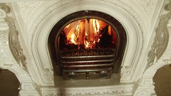 White fireplace in which the fire burns top view Stock Footage