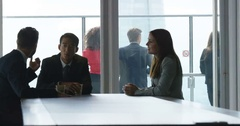 4K City workers talking during coffee break in corporate office building Stock Footage