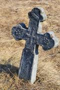 Old stone grave cross Stock Photos