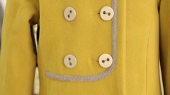 The yellow button on the coat Stock Footage