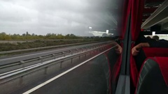 Iew from a bus window on highway Stock Footage