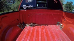 Aerial shot of a pickup truck bed and lake house, slow motion. Stock Footage