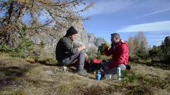 Friends hikers relaxing. Park of the Ampezzo Dolomites, Italy Stock Footage