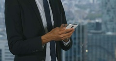 4k, Young businessman using mobile phone in office. Stock Footage
