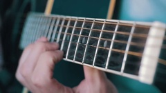 Man Playing Acoustic Guitar. Slow Motion Stock Footage