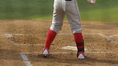 A batter makes a play at a baseball game, slow motion. Stock Footage