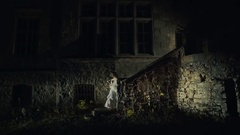 On the night of Halloween bride coming down the stairs of old abandoned medieval Stock Footage