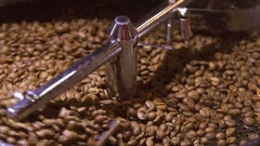 Coffee roasting in coffee roaster Stock Footage