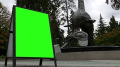 Motion of green screen sign beside Vancouver aquarium totem Stock Footage