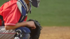 A catcher makes a play at a baseball game, slow motion. Stock Footage