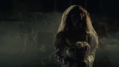 Creepy lone bride near misty medieval castle Stock Footage