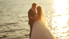 Young groom wearing elegant suit and beautiful bride in white luxury wedding Stock Footage