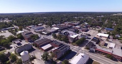 Aerial of Small Town with Downtown and Water Tower Stock Footage