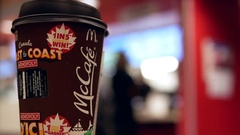 Close up hot Mccafe coffee at mcdonalds fast food restaurant Stock Footage