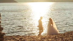 Portrait of newlywed couple in green sunny place in countryside Stock Footage