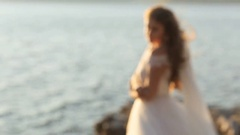 Young beautiful attractive bride walking alone in the hill of the mountain Stock Footage