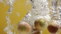 Peaches falling in water Stock Footage