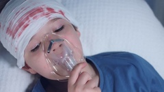 4k Hospital Shot of a Sick Child Breathing with Oxygen Mask on Face Stock Footage