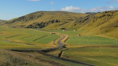 Beautiful landscape of big icelandic farm, road and green mountains Stock Footage