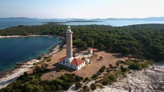 Aerial - Flying away from the tower top of Punta Bjanca lighthouse in the Adriat Stock Footage