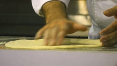 Chef puts the pizza dough on the kitchen table Stock Footage