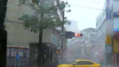 City streets and motorists in Typhoon Wind and Rain Stock Footage