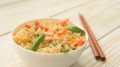 Appetizing healthy rice with vegetables Stock Footage