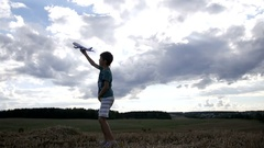 Boy dreams of becoming a pilot, boy playing with an airplane in the sky Stock Footage