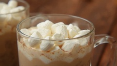 Homemade cocoa with cinnamon and baked marshmallows Stock Footage