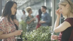 4K Happy mixed ethnicity group of friends socializing at city rooftop party Stock Footage