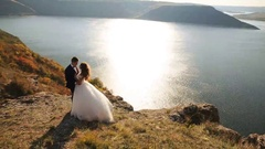 Handsome husband holding his happy bride in the picturesque place on the Stock Footage