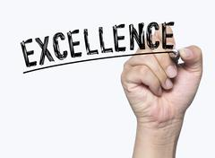 Excellence written by hand Stock Photos