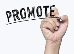 Promote written by hand Stock Photos