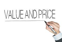 Value and price written by hand Stock Photos