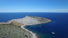 Aerial - Flying toward plain and bare peninsula of one of Kornati Islands Stock Footage