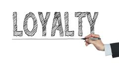 Loyalty written by hand Stock Photos