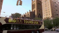 Big Bus Tours USA driving down 5th Ave with church in background Manhattan NYC Stock Footage
