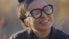 Urban Model Woman in Fashion coat and glasses Having Fun. Glamour Sexy Hipster Stock Footage