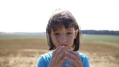 Girl with scratches on the face removes his hat look at the camera and combed Stock Footage