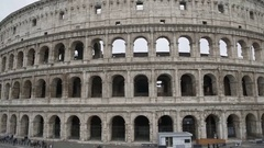 Facade of Colosseum amphitheatre, ancient venue for gladiatorial contests, Italy Stock Footage
