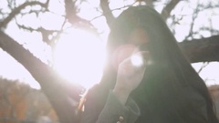 Outdoor sensual portrait of young beautiful stylish woman with long dark hair Stock Footage