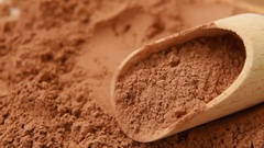 Cocoa powder close-up on wooden background Stock Footage