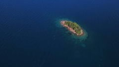 Aerial - Flying above small uninhabited island Stock Footage