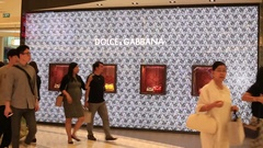 People near Dolce & Gabbana store in Siam Paragon Mall. Bangkok, Thailand Stock Footage