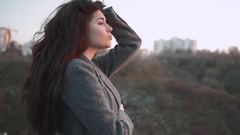Young woman warming herself in autumn. Cold fall day. Woman freeze on sunset on Stock Footage