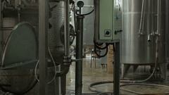 Tanks in the plant for fruit processing,juice production factory, tilt up by Cut Stock Footage