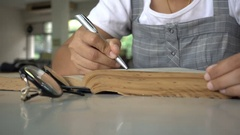 Woman open old book and find at library Stock Footage