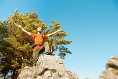 Young male with beard is traveling through the mountain, tourist rucksack Stock Photos
